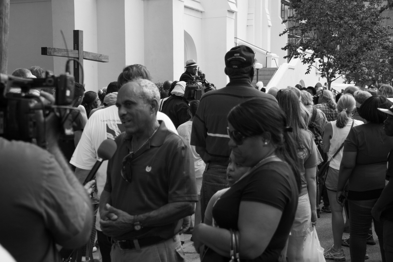 News reporters interview individuals gathered at Emanuel AME Church for a prayer vigil, photograph by Delane Chavez, June 20, 2015, Charleston, South Carolina.