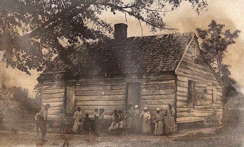 Photograph of a group of African American women and children in front of a wooden building, Redcliffe Plantation, Beech Island, South Carolina, circa 1900, courtesy of South Caroliniana Library at the University of South Carolina.