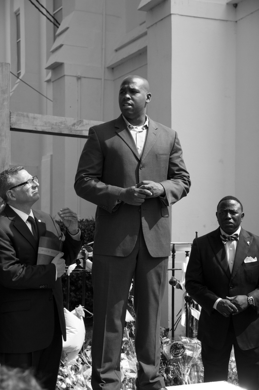 A pastor speaking to the crowd gathered outside of Emanuel AME Church, photograph by Delane Chavez, June 20, 2015, Charleston, South Carolina.