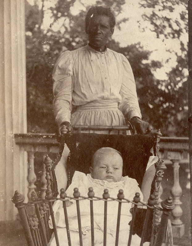 "Photograph of an African American woman, Celia, working as a domestic laborer, caring for a white infant, Redcliffe Plantation, Beech Island, South Carolina, 1898, courtesy of South Caroliniana Library at the University of South Carolina. After emancipation, one avenue of employment that remained open to African American women was child care for white families. White families continued to use the term ""Mammy"" to refer to the African American woman they employed to care of their children."