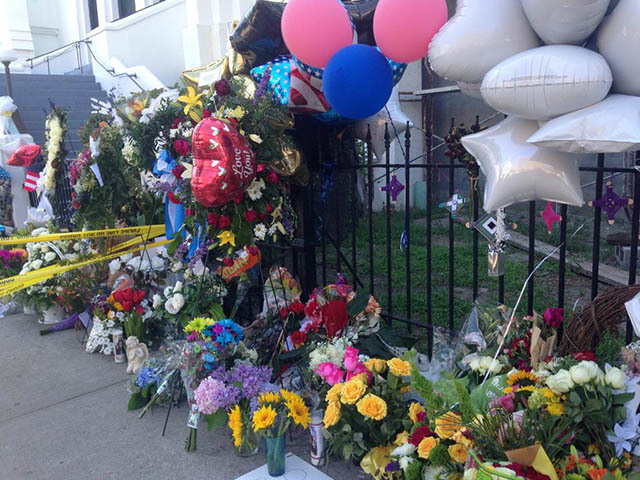 Balloons, flowers, letters, posters, candles, stuffed animals, and other items left outside the Emanuel AME Church, June 25, 2015, Charleston, South Carolina, courtesy of ABC New4 WCIV-TV.
