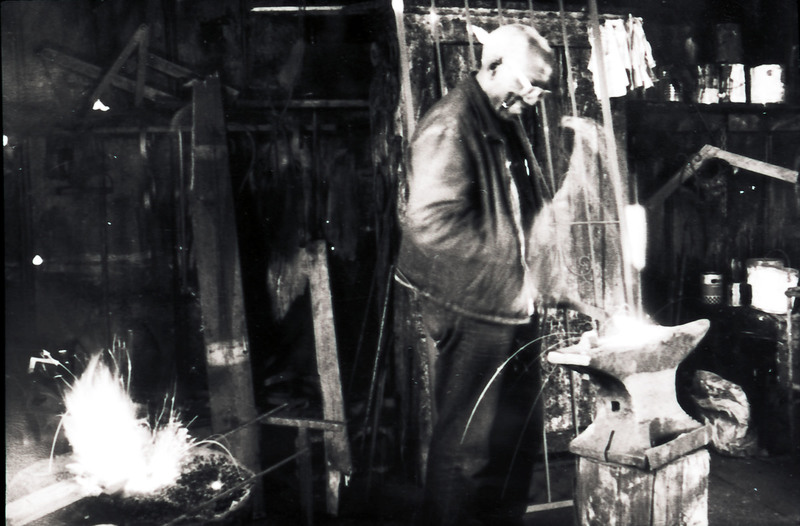 Philip Simmons hammering at his anvil in his workshop, Philip Simmons Collection, courtesy of the Avery Research Center.