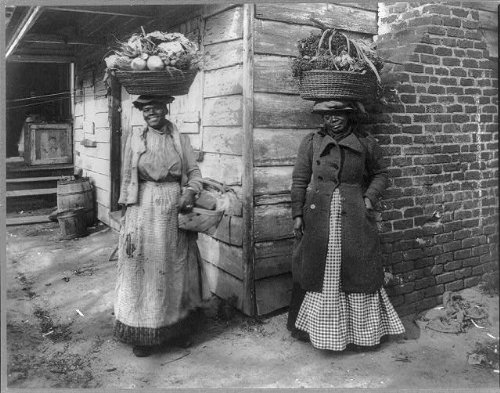 African American women carrying baskets on heads, circa 1920, courtesy of the Library of Congress.