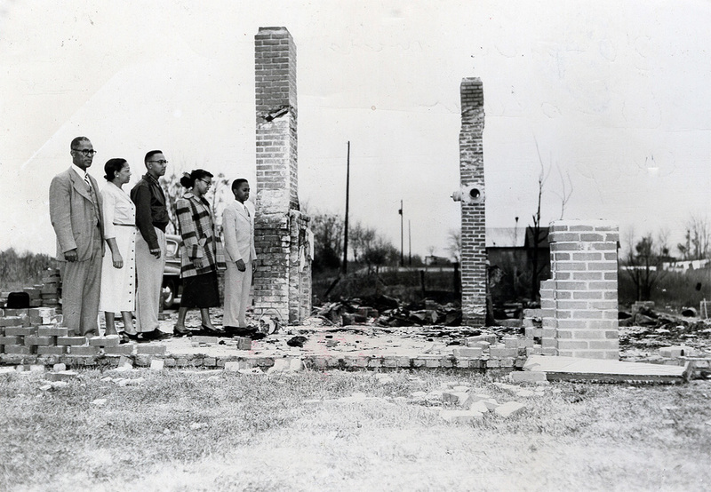 Joseph A. DeLaine and family looking over the ruins of their burned out home, Summerton, South Carolina, 1950, Joseph A. DeLaine Papers, courtesy of the South Caroliniana Library, University of South Carolina.
