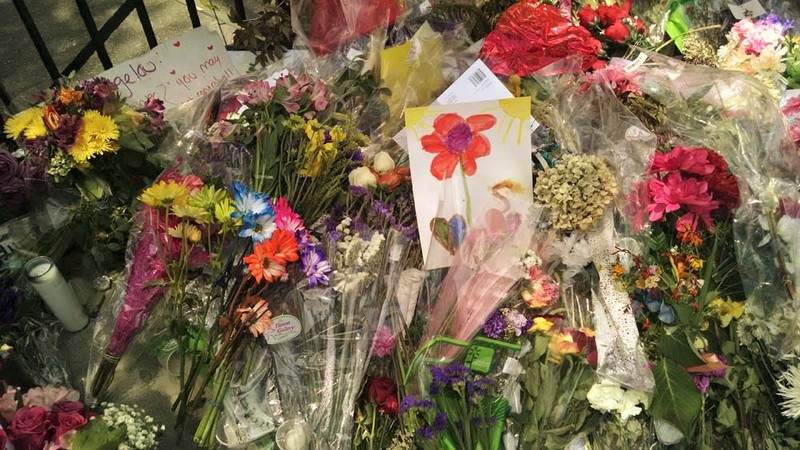 A child's drawing placed among flowers left at the Emanuel AME Church, photograph by Toni Carrier, June 23, 2015, Charleston, South Carolina.