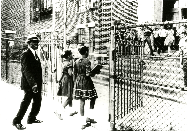 Clarence Ford, his daughter Barbara, and Oveta Glover walk into the formerly all-White James Simons Elementary School, September 3, 1963, Charleston, South Carolina, courtesy of the Avery Research Center.