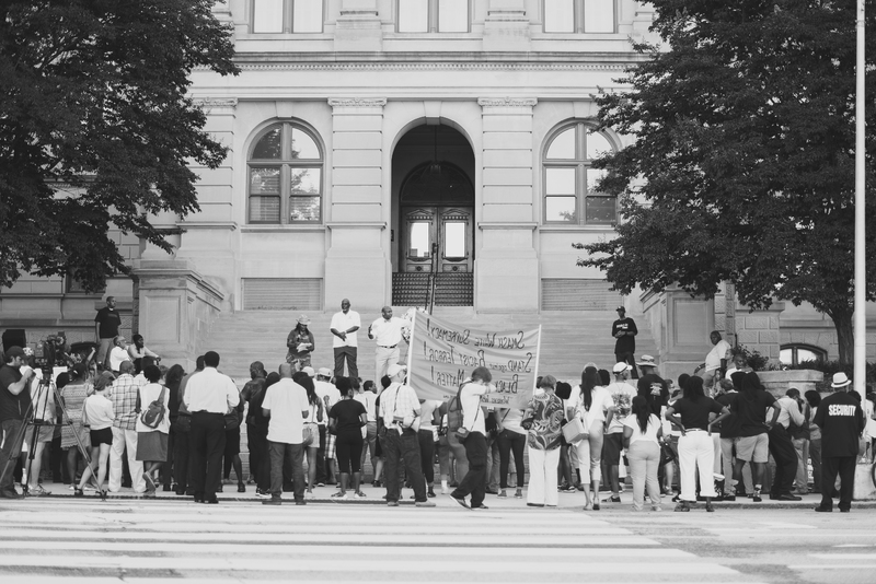 Marchers gather outside of the Georgia State Capital for a march and vigil in honor of the victims at the Emanuel AME Church, photograph by Calvin Lionel, June 19, 2015, Atlanta, Georgia.