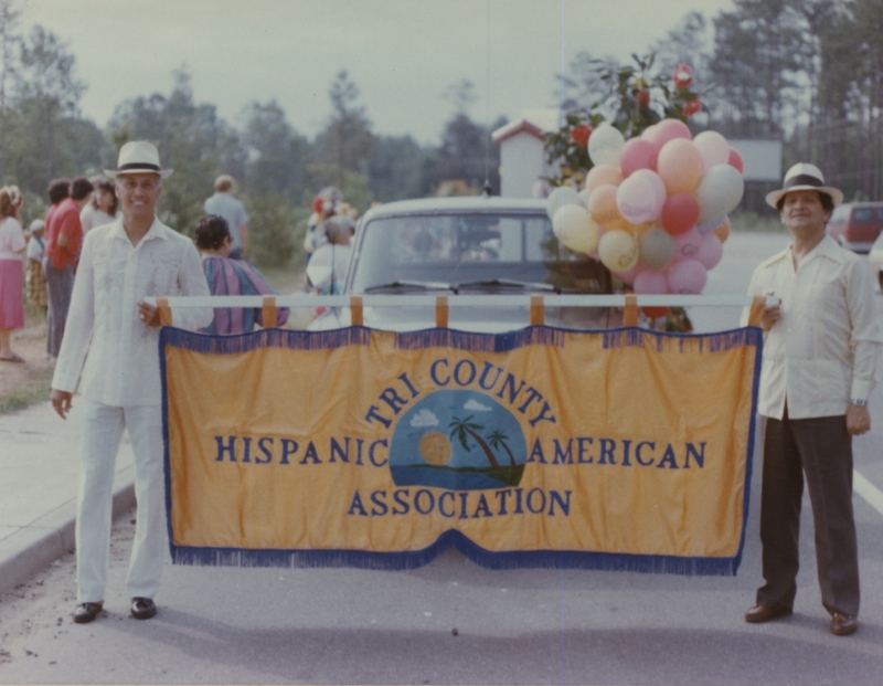 Tri-County Hispanic American Association members with banner, South Carolina, circa 1990, courtesy of Ángel Cordero.
