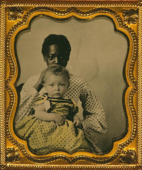 Portrait of an African American woman holding a white child, 1855, courtesy of the Library of Congress.