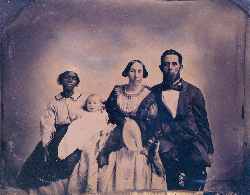 Group portrait of a white family and an African American girl, New Market, Virginia, circa 1860, courtesy of Slavery Images.