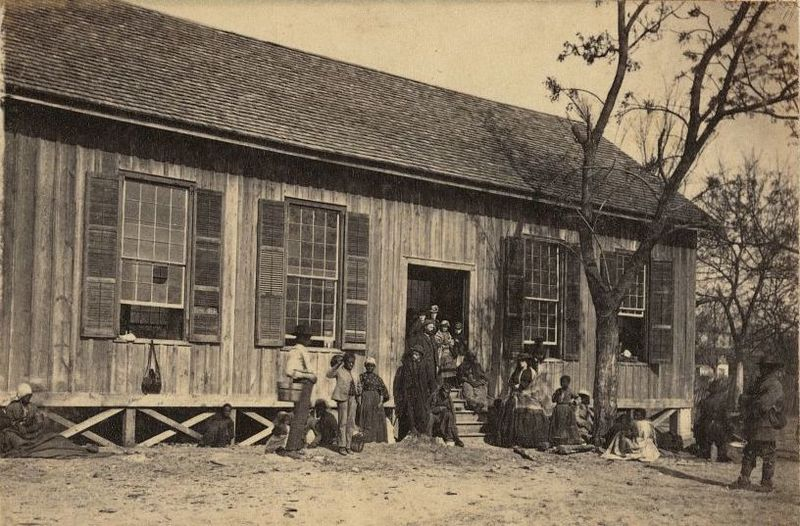 African American children and adults standing outside a Freedmen's school, photograph by Samuel A. Cooley, Edisto Island, South Carolina, circa 1865, courtesy of the Library of Congress.