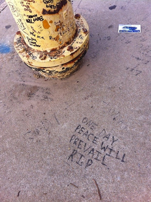 The fire hydrant and sidewalk in front of Emanuel AME Church covered in hand-written notes, photograph by Mary Battle, September 5, 2015. Charleston, South Carolina.