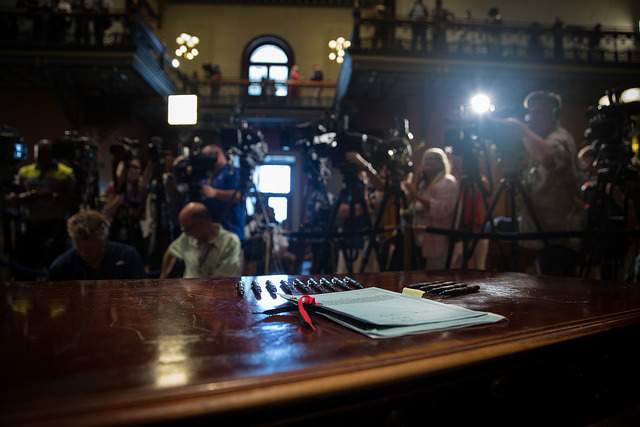 The Confederate flag bill waiting for South Carolina Governor Nikki Haley's signature with nine pens representing the nine killed in the Emanuel AME Church shooting, photograph by Zach Pipin, July 10, 2015, Columbia, South Carolina.