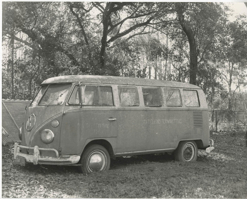 """Citizens Committee bus, Esau Jenkins Papers, courtesy of the Avery Research Center. On the back of his Citizen Committee bus, activist Esau Jenkins painted one of his favorite mottos: """"Love is progress. Hate is expensive."""""""