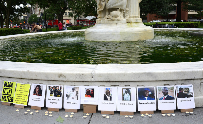 Photographs of the nine victims killed in the mass shooting in Charleston, South Carolina at the Dupont Circle fountain, photograph by Stephen Melkisethian, June 18, 2015, Washington, D.C.