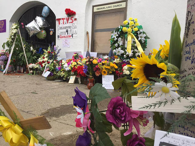 Flowers left outside of the Emanuel AME Church, June 25, 2015, Charleston, South Carolina, courtesy of ABC New4 WCIV-TV.
