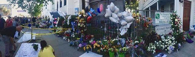 Memorabilia left along the fence and around the corner at the Emanuel AME Church, June 25, 2015, Charleston, South Carolina, courtesy of ABC New4 WCIV-TV.