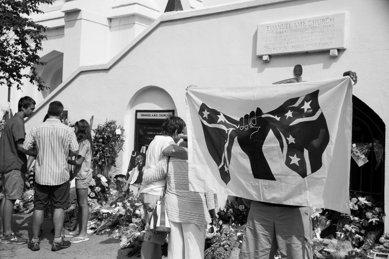 A visitor to the Emanuel AME Church protesting the Confederate flag, photograph by Delane Chavez, June 20, 2015, Charleston, South Carolina.  That same day, the media uncovered images of shooter Dylann Roof posing with the Confederate flag.