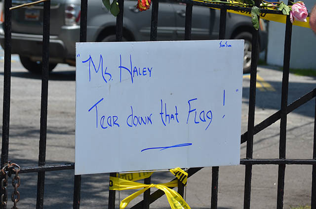 Sign demanding that South Carolina Governor Nikki Haley remove the Confederate flag from the State House grounds outside of the Emanuel AME Church, June 20, 2015, Charleston, South Carolina, courtesy of ABC New4 WCIV-TV.