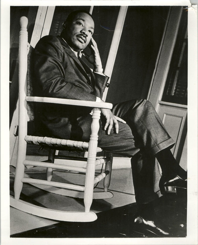 """Martin Luther King, Jr. Sitting on Rocking Chair,"" photograph, Septima P. Clark Papers, courtesy of the Avery Research Center."