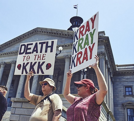 Anti-KKK protesters at the KKK rally in support of the Confederate flag on South Carolina State House grounds, photograph by Zach NeSmith, July 18, 2015, Columbia, South Carolina.