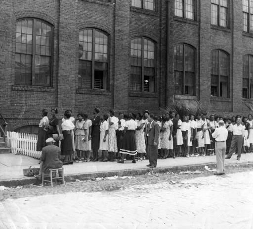 Picketing workers outside of the Cigar Factory building, ca. 1945, Charleston, South Carolina, Georgia State University, Southern Labor Archives.