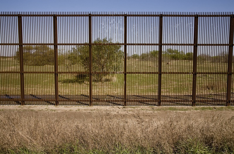 Border wall between Mexico and the United States, photograph by Susan Harbage Page, near Brownsville, Texas, 2010.