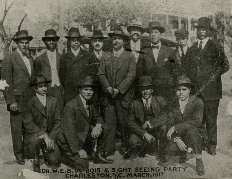 """""""Dr. W. E. B. Du Bois & Sight Seeing Party,"""" Charleston, South Carolina, 1917, courtesy of the Avery Research Center. W. E. B. Du Bois (center), Avery Principal Benjamin Cox (top row, fourth from left). Du Bois, a founding member and leader of the NAACP, visited Charleston in March 1917 to rally community support for the city's newly formed NAACP branch. Teddy Harleston and other founding members of the Charleston branch met with Du Bois during his visit."""