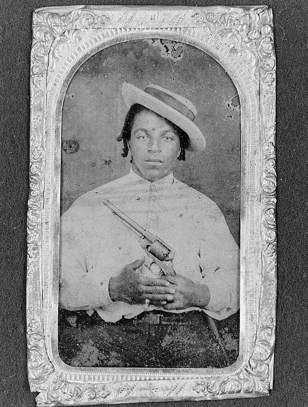 African American wearing hat and holding revolver, ca. 1860-1870, Gladstone Collection of African American Photographs, courtesy of the Library of Congress.