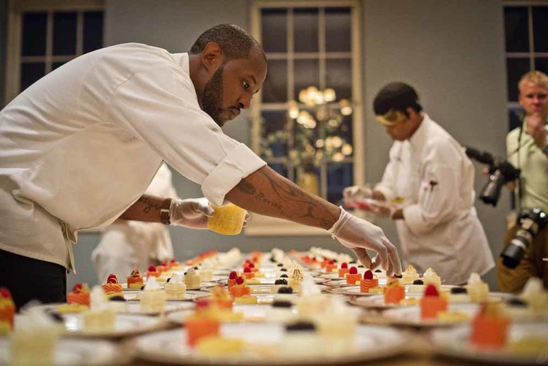 The final decorative touches on dessert, photograph by Jonathan Boncek, Charleston, South Carolina, April 19, 2015.