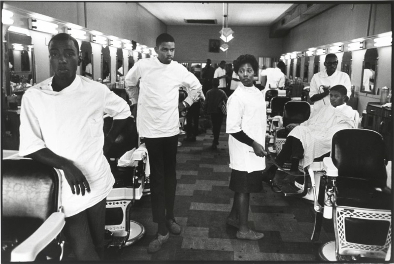 Interior of a Black barbershop, Charleston, South Carolina, photograph by Leonard Freed, 1963, courtesy of the National Museum of African American History and Culture.