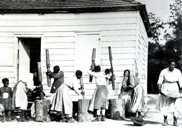 "Women laborers ""pounding rice the hard way,"" Hobcaw Barony Plantation, Georgetown County, South Carolina, circa 1900, courtesy of the Georgetown County Public Library."