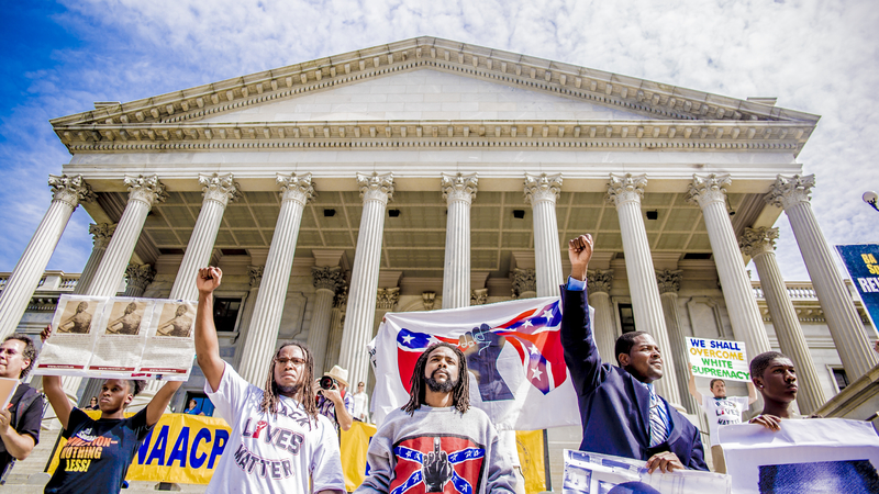 Counter-protesters outnumbering the KKK at the Confederate flag rally on the South Carolina State House grounds, photograph by Hunter Boone, July 4, 2015, Charleston, South Carolina.