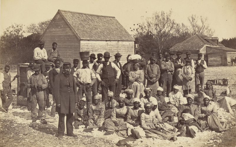 Photograph depicting a large group of African Americans on the Fish Haul Plantation, photograph by Henry P. Moore, Hilton Head, South Carolina, circa 1862, courtesy of the J. Paul Getty Museum.