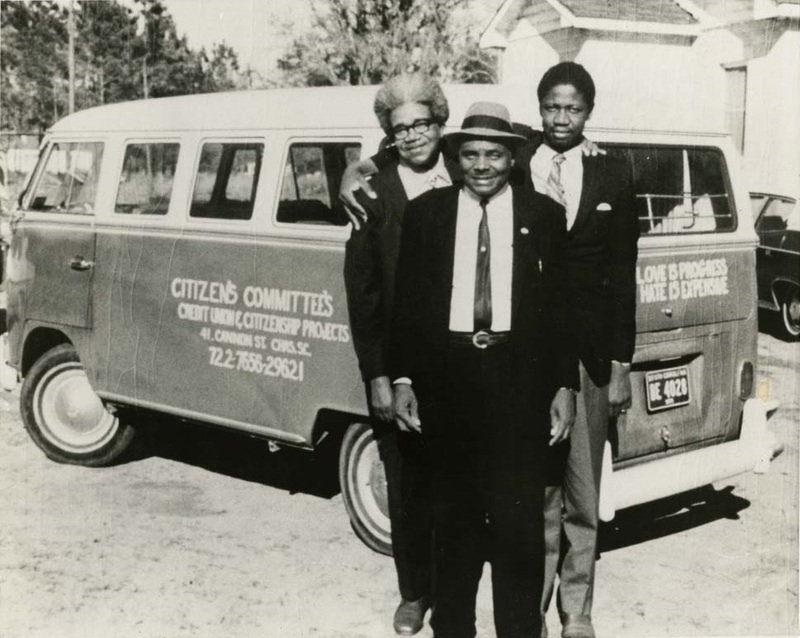 Esau Jenkins (center) in front of the Citizen's Committee bus, accompanied by Reverend Willis Goodwin (right) and Alfred Fields (left), ca. 1950s and 60s, courtesy of the Avery Research Center.