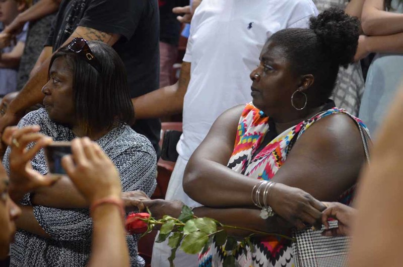 People holding hands at the City of Charleston's prayer vigil, June 19, 2015, Charleston, South Carolina, courtesy of ABC New4 WCIV-TV.  After the event attendees walked to Emanuel AME Church to lay roses outside.