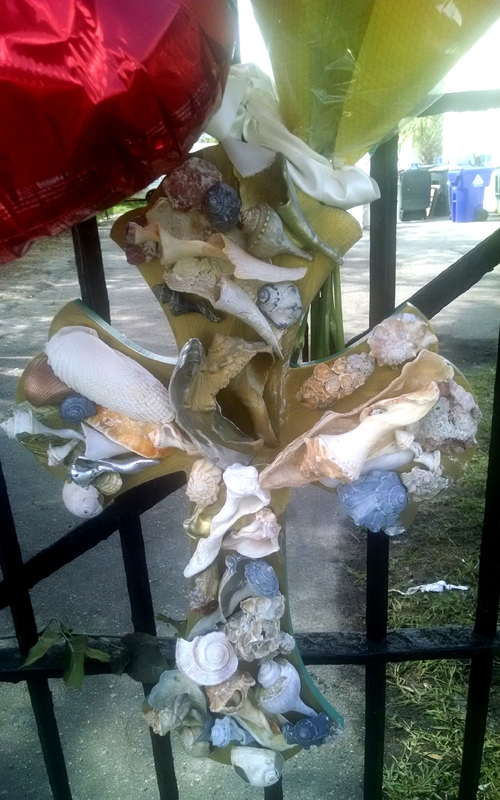 A cross with seashells left by visitors at the Emanuel AME Church, photograph by Toni Carrier, June 29, 2015, Charleston, South Carolina.