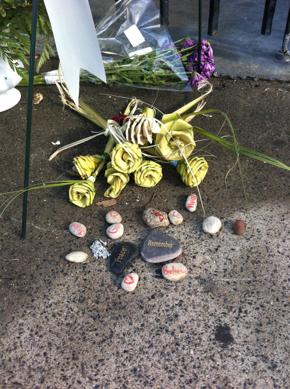 Palmetto roses and stones placed outside the Emanuel AME Church, photograph by Meg Moughan, July 7, 2015, Charleston, South Carolina.