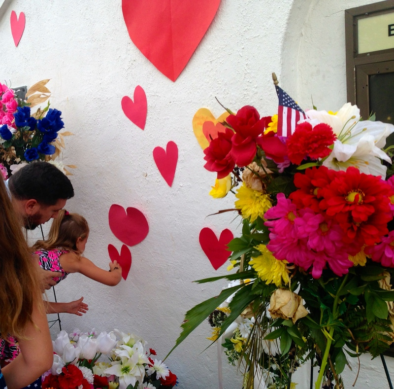 A young girl signs a heart at the Young Preservationists' event at the Emanuel AME Church, photograph by Brittany Lavelle Tulla, July 8, 2015, Charleston, South Carolina.