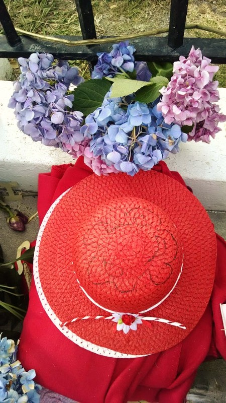 A red hat left alongside hydrangeas at the Emanuel AME Church, photograph by Toni Carrier, June 23, 2015, Charleston, South Carolina.