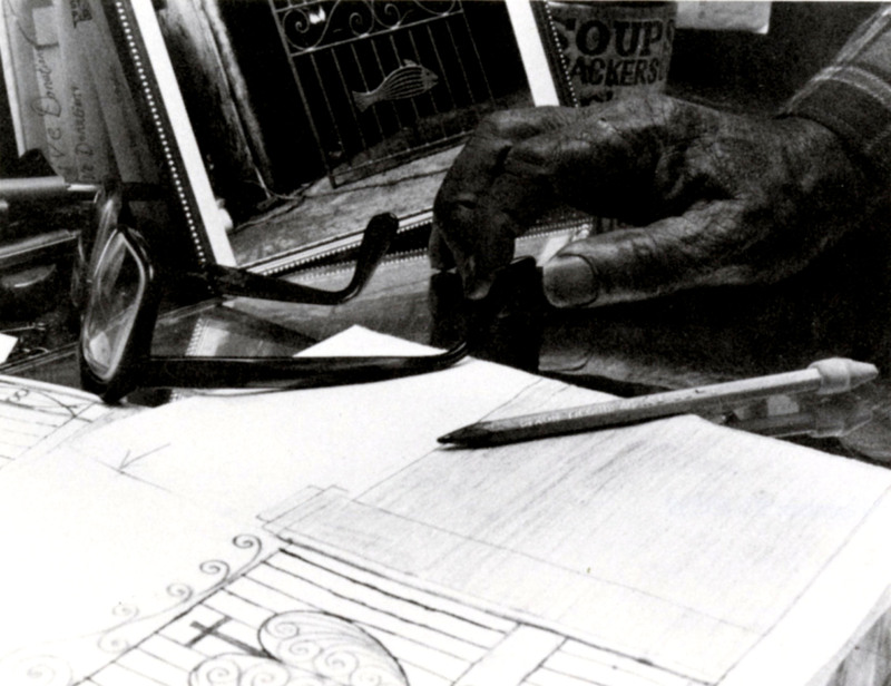 Philip Simmons at his desk, 1993, photograph by Claire Y. Greene, <em>Keeper of the Gate</em><em>: Designs in Wrought Iron by Philip Simmons, Master Blacksmith</em>, courtesy of the Philip Simmons Foundation.
