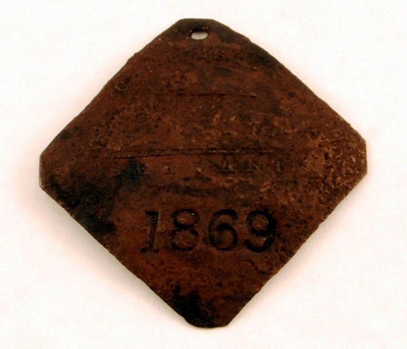"Copper slave badge imprinted ""Charleston 1840 Servant 1869,"" Walter Pantovic Artifact Collection, courtesy of the Avery Research Center of African American History and Culture."