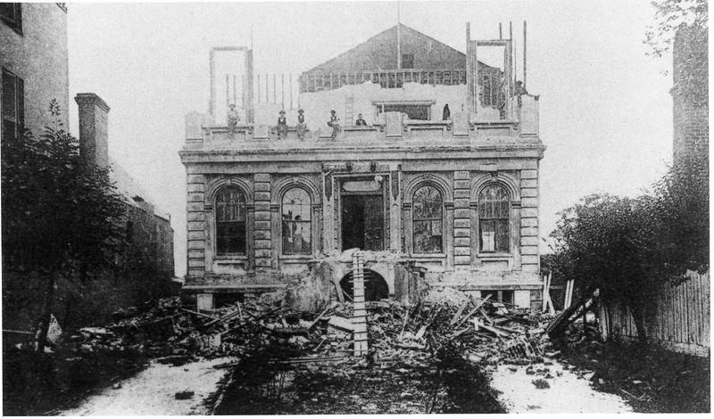 Photograph of the former Charleston Club on Meeting Street following the earthquake of 1886, courtesy of the Preservation Society of Charleston.