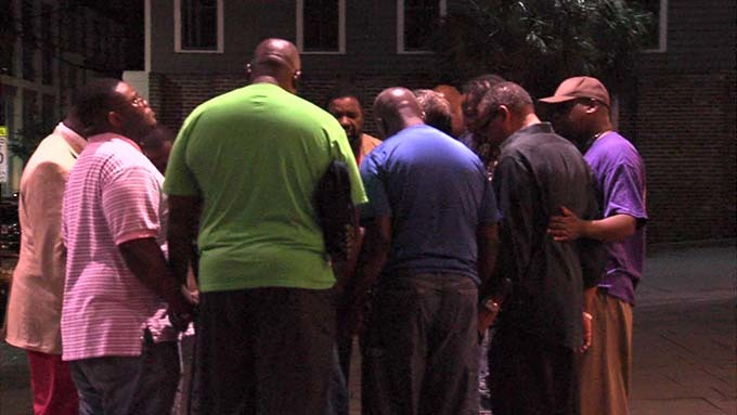 Local people gathered in a prayer circle near the Emanuel AME Church immediately following the shooting, June 17, 2015, Charleston, South Carolina, courtesy of ABC New4 WCIV-TV.