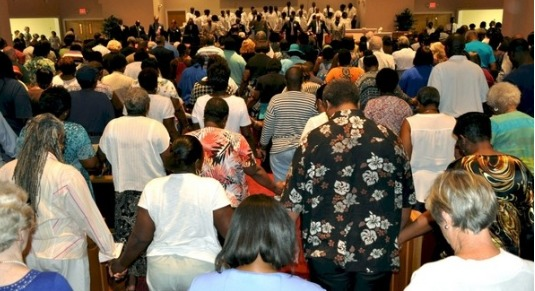 Prayer vigil at St. Stephen AME Church, photograph by Max Hrenda, June 22, 2015, Georgetown, South Carolina, courtesy of <em>South Strand News</em>.