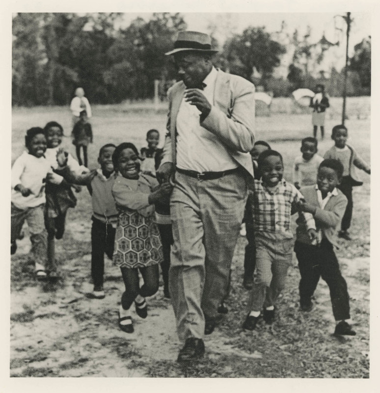 """Esau Jenkins Gathering With Kids,"" Johns Island, South Carolina, ca. 1960s, Esau Jenkins Papers, courtesy of the Avery Research Center."