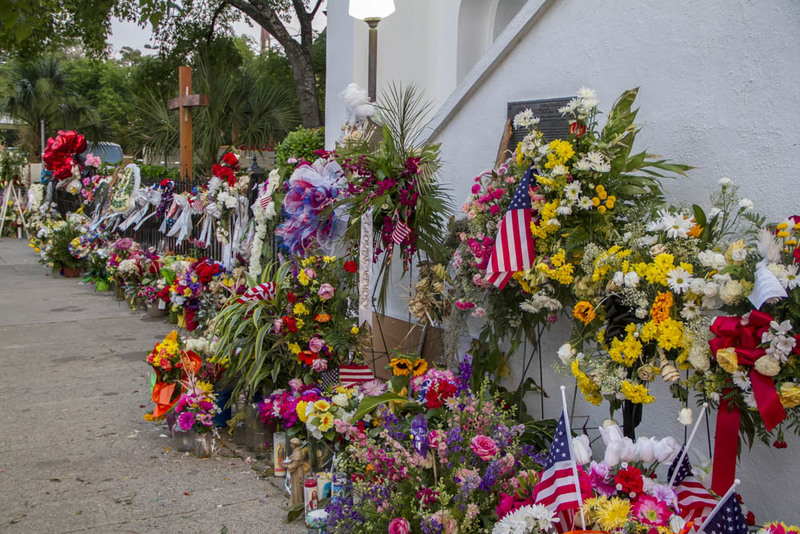 Flowers, candles, notes, and other memorabilia left outside of the Emanuel AME Church, photograph by Brandon Coffey, June 29, 2015, Charleston, South Carolina.