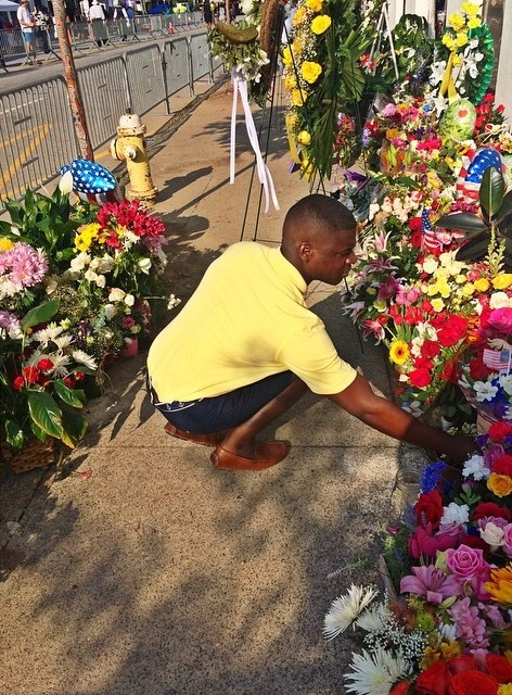 Visitor laying flowers at the Emanuel AME Church, Instagram photograph by Breyon, July 2015, Charleston, South Carolina.
