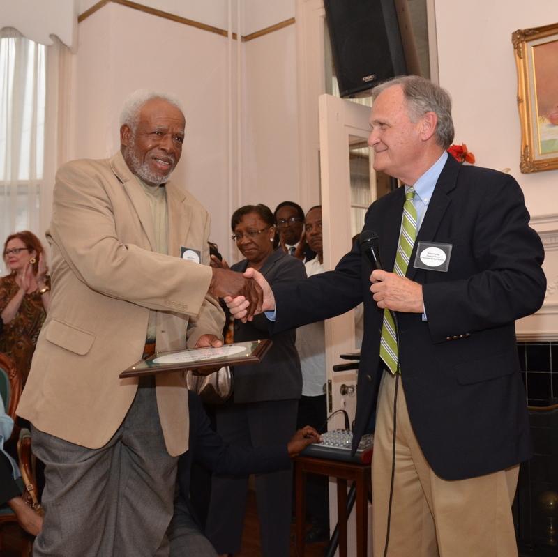 Henry Palmer, master mason, accepting the Thomas Mayhem Pinckney Craftsmanship Award from Robert Gurley, then Preservation Society Director of Historic Preservation, 2013, courtesy of the Preservation Society of Charleston.