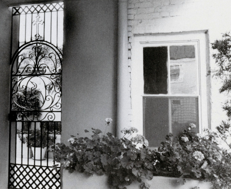 """""""Cross and Egret Gate,"""" 2 St. Michael's Alley, Charleston, South Carolina,1993, photograph by Claire Y. Greene,<em>Keeper of the Gate</em><em>: Designs in Wrought Iron by Philip Simmons, Master Blacksmith</em>, courtesy of the Philip Simmons Foundation."""